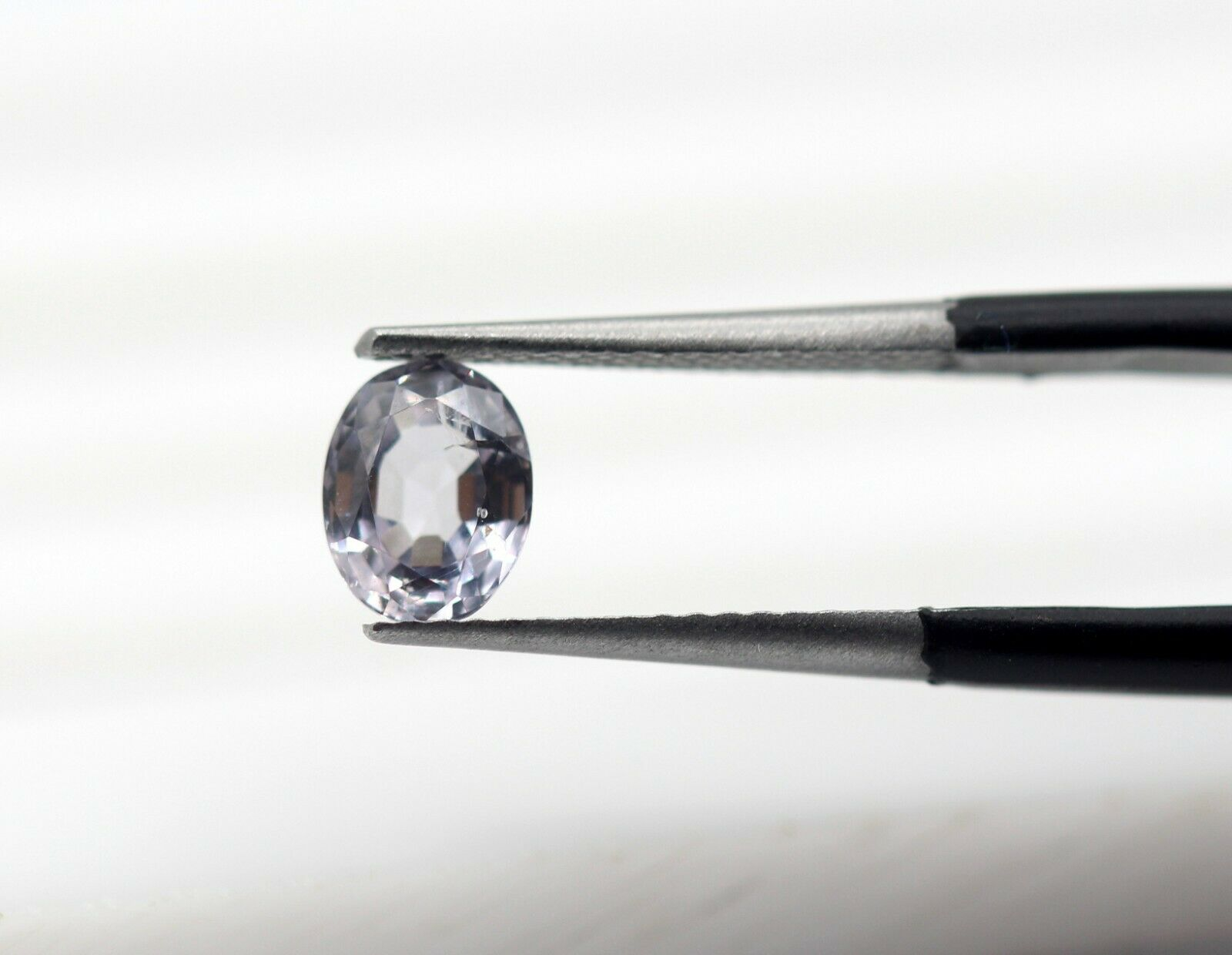 0.86 Ct White Sapphire Natural Gemstone With Light Purple Color Hue Oval Cut Certified