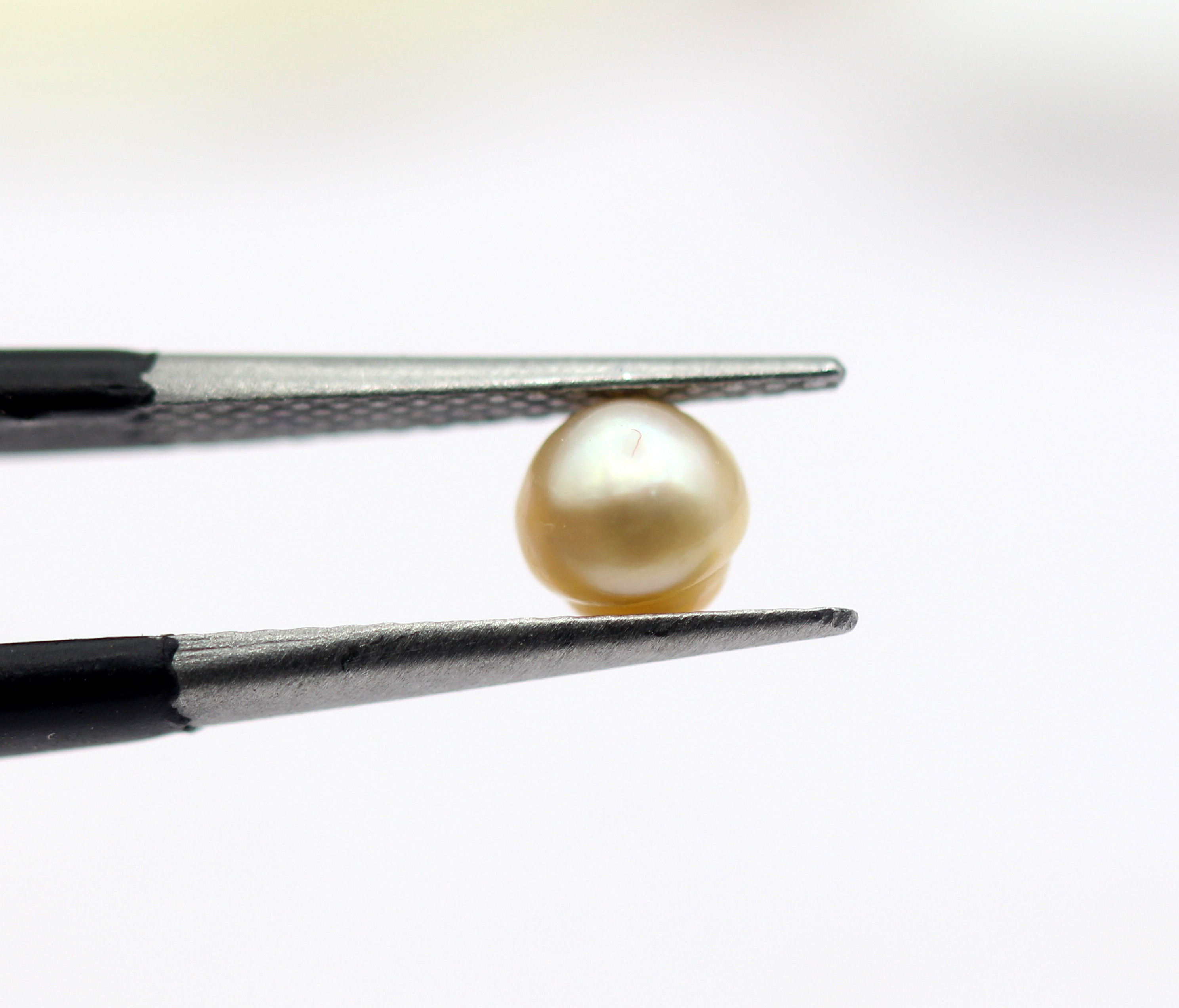 0.69 Ct Basra Pearl Natural Gemstone Golden White Color Certified