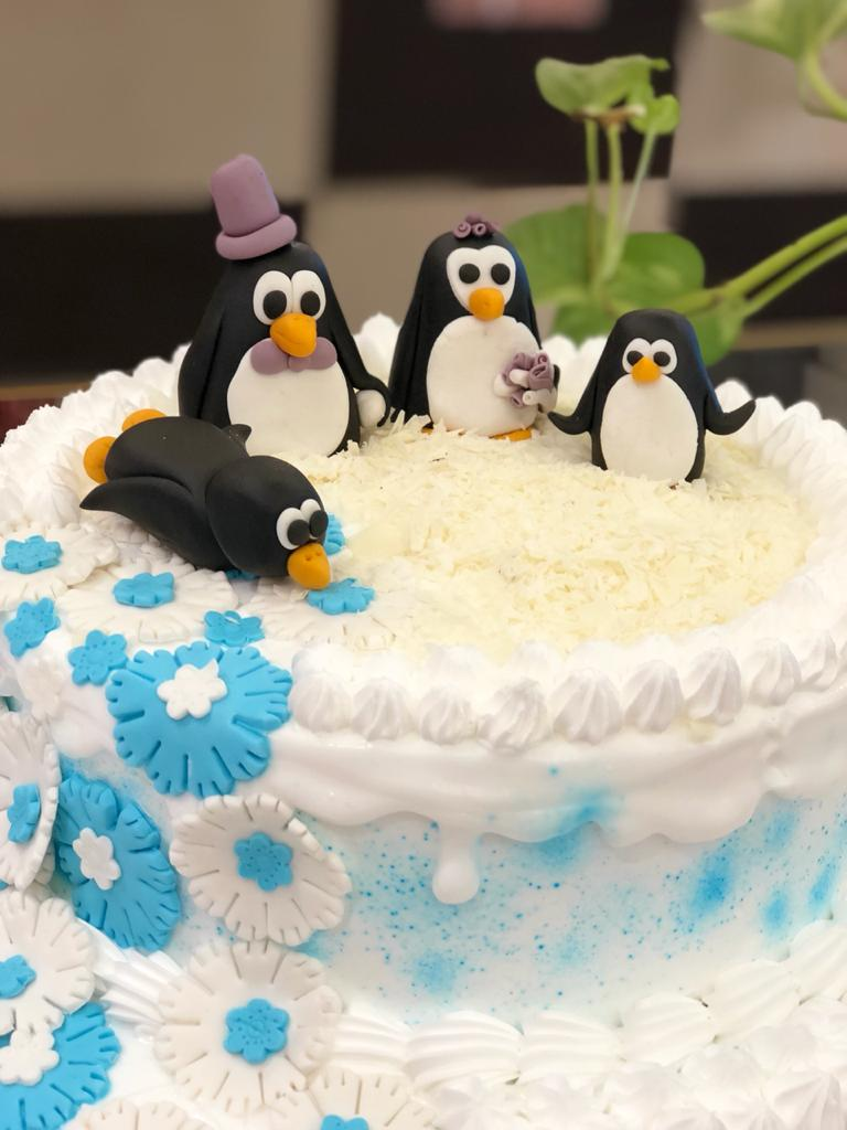 Penguin On The Ice Cake